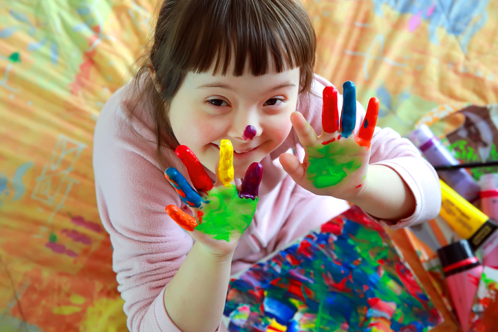 Young girl using finger paint