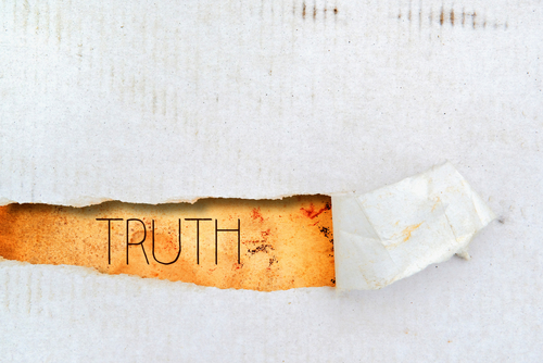 Truth title on old grunge torn paper