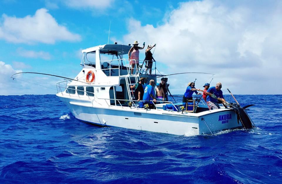 pulling the 150kg blue marlin on board.jpg