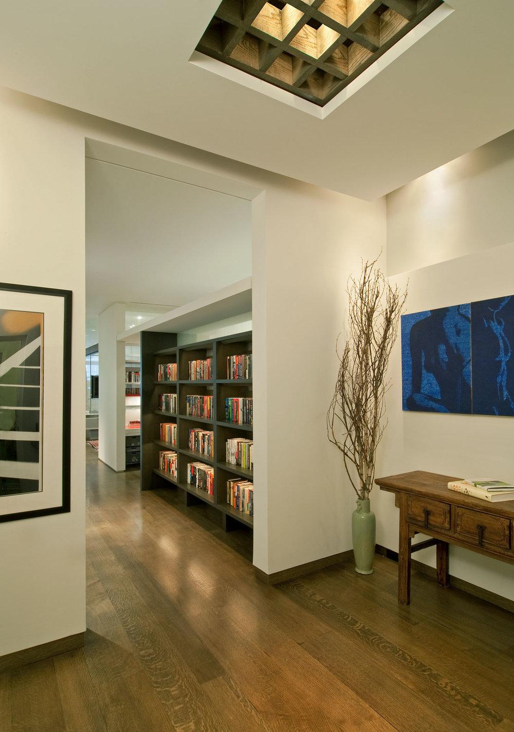 NYC Loft Renovation - Entrance foyer and bookshelf system