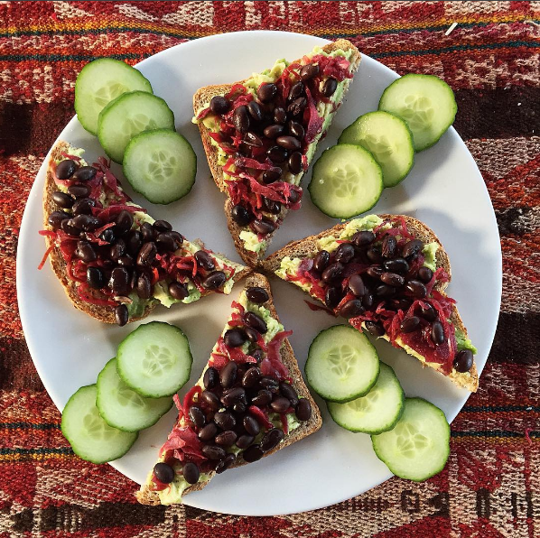 "Avocado Toast Pinwheel ""One of my favorite meals is avocado toast with a twist. I like adding black beans for some plant-based protein and sauerkraut for gut health"" ~Lizzy"