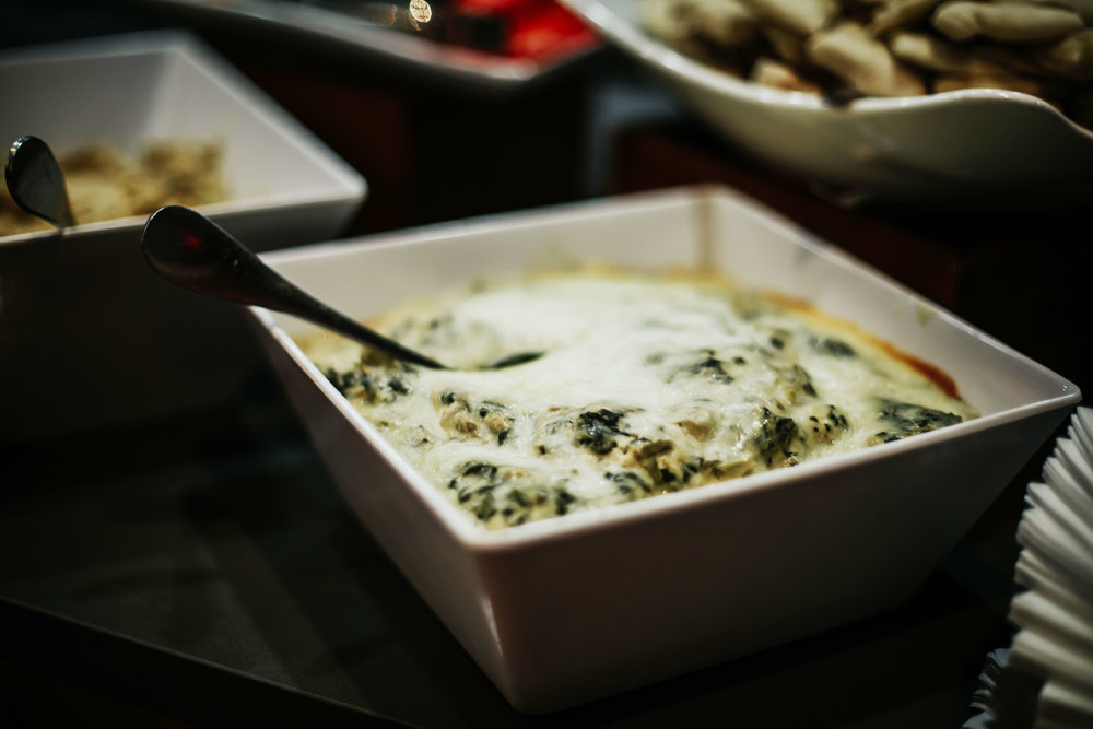 Spinach, artichoke & triple cream cheese dip. Photo by  Dani G Photography .