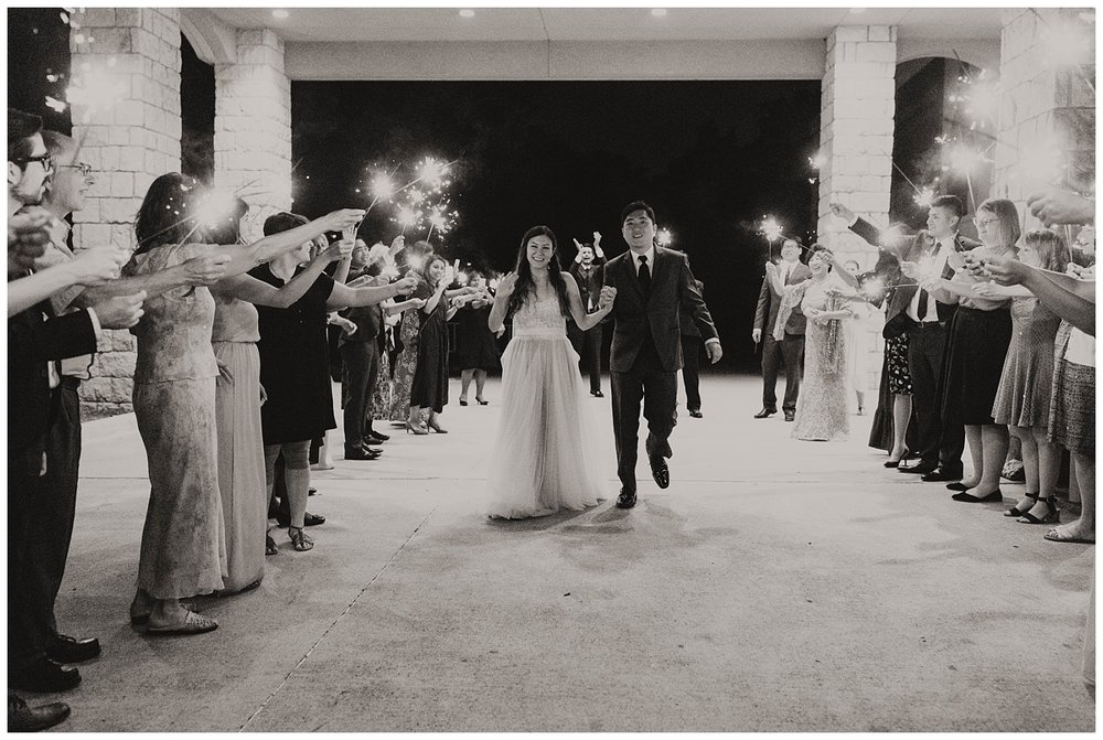 Farewell at the end of the night. Wedding sparkler exit.