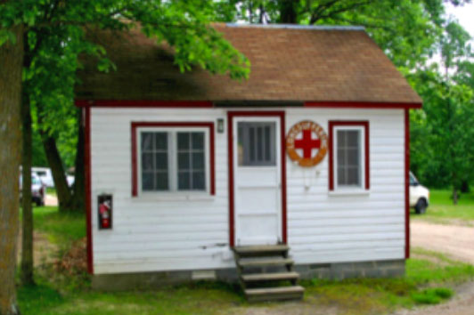 Nurse's Cabin - The Nurse's Cabin has 2 small bedrooms, a sitting room and the convenience of a restroom with toilet and sink. A small fridge is available to store medications and ice packs and there is a locker for medications.