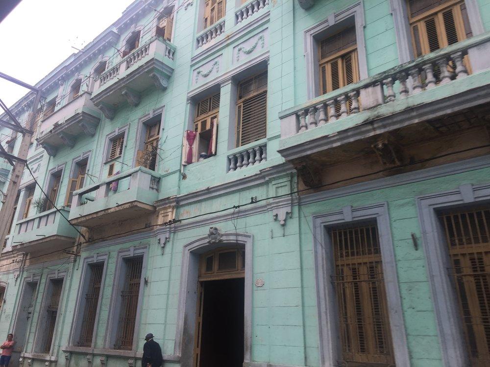 Light teal apartment building in Havana, Cuba