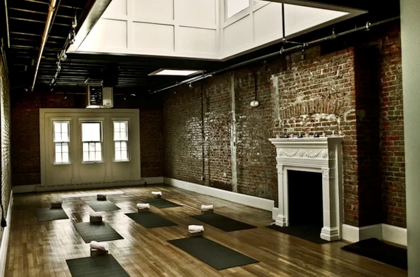 - Here you can see a picture of a yoga studio. The room is light filled but is pretty bland. We could add some furniture to the space but the built in lighting would not do much to change the FEEL of the room when you walk in.