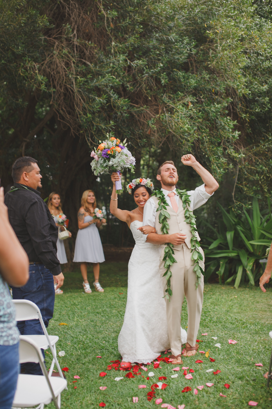 Groom and Bride Exit at Maui Wedding Venue Bailey House Museum