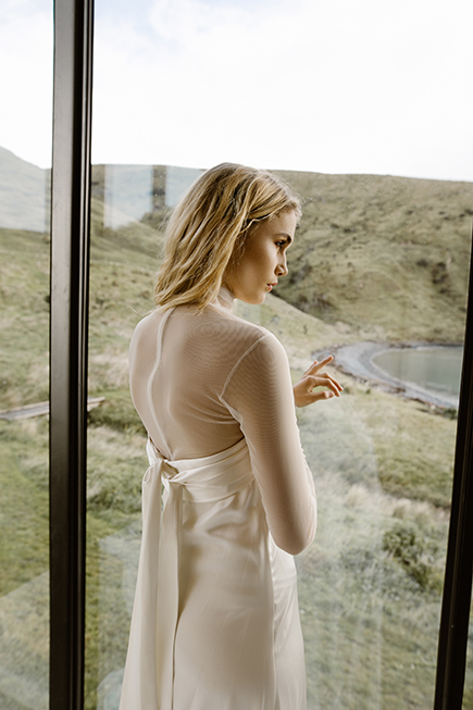 Unique wedding gown with a tulle turtle neck top to be worn under for the ceremony and then taken off for reception by L'eto Bridal