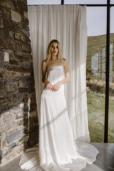 Minimalist Bridal Attire for a city chic : ivory satin loosely  wrapping the body in a very new and modern  fashion #letobridal