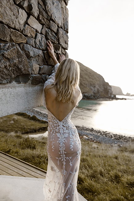 Stunning deep v back on this L'eto Bridal wedding gown Piece 8 would make you feel chic and elegant as well as sensual on your wedding day