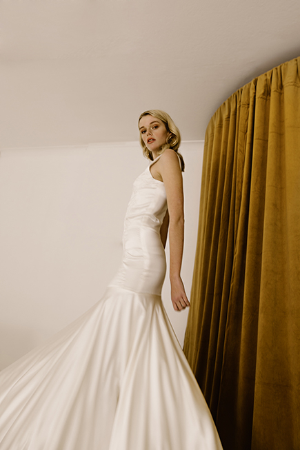 Delocae embroidery on this fitted wedding dress is stunningby L'eto Bridal