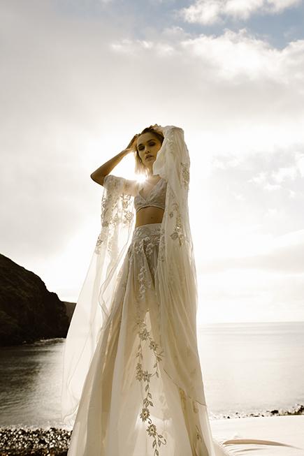 model wearing our coachella bridal set into the sun set