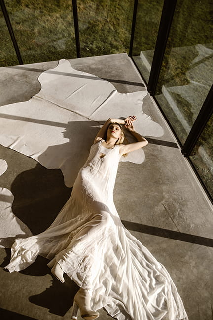 Piece 2 is an a line sleeveless wedding gown with minimal embroidery