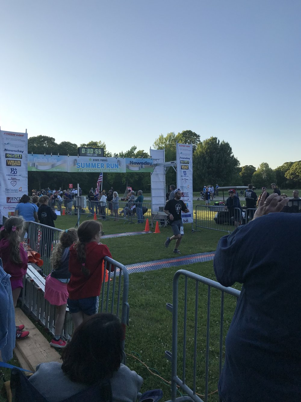 Glen beat his last 5 mile time by 1:15 to place 2nd in his age group. Here he is at the finish line.