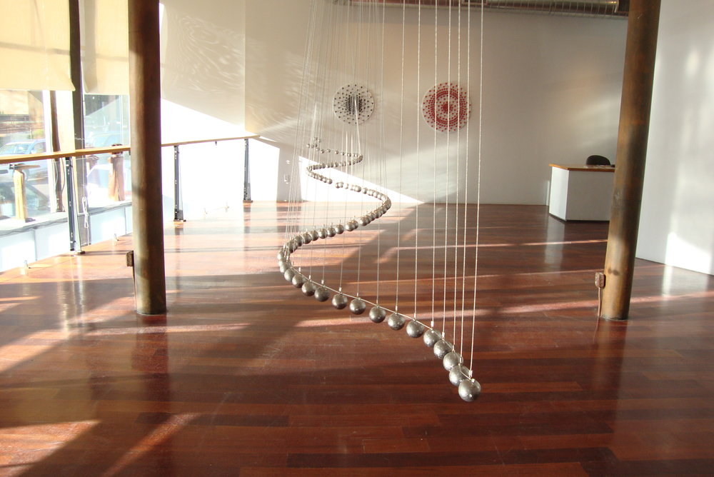 Wave Line, interactive kinetic sculpture, lead, cable, 12'x6'x12'