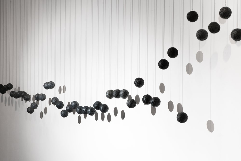 50 Springs, collaboration with Rob Hart, kinetic sculpture, recycled inner tubes, motor, springs, 9'x16'x7'