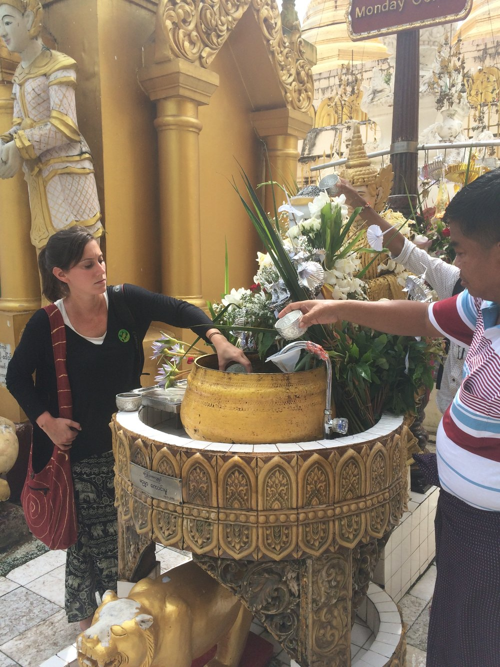 Partaking in rituals at Shwedagon Pagoda in Yangon, Myanmar