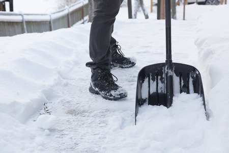 50917434_S_shoveling_snow_boots_man_winter.jpg