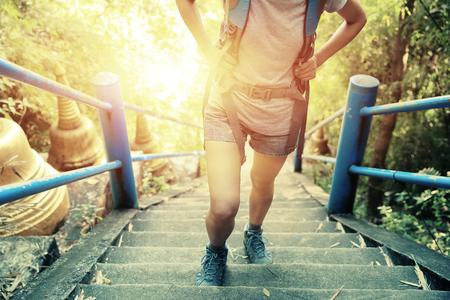 49992480_S_hiking_feet_woman_steps_backpack_.jpg