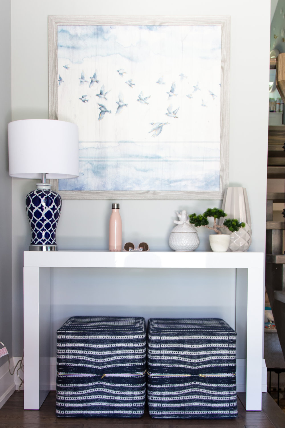 white-and-blue-upholstered-ottoman