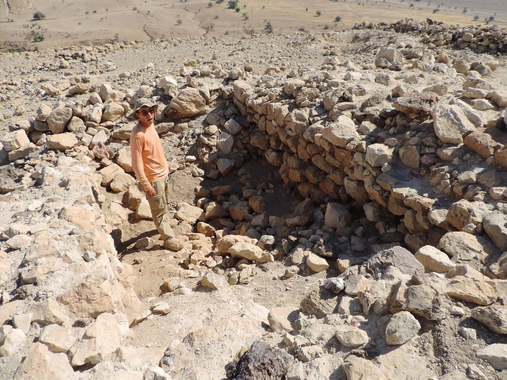 (9) Student Standing inside Remains of a Large Structure at Kh. Auja el-Foqa.jpg