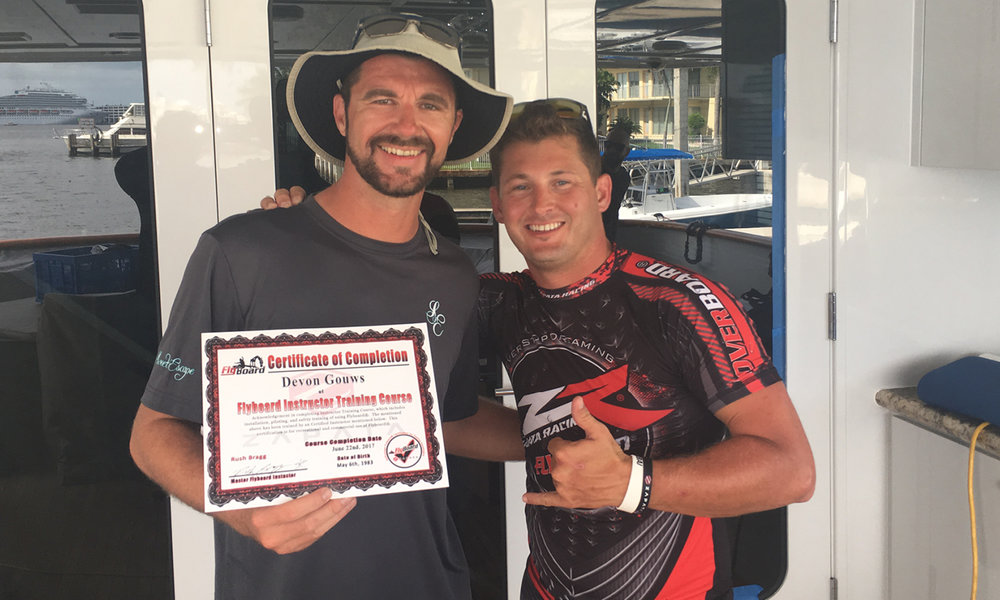 Devon Gouws (left) of Motoryacht Sweet Escape receives his Certificate from Rush Bragg (right) upon completing the Flyboard Instructor Training Course.