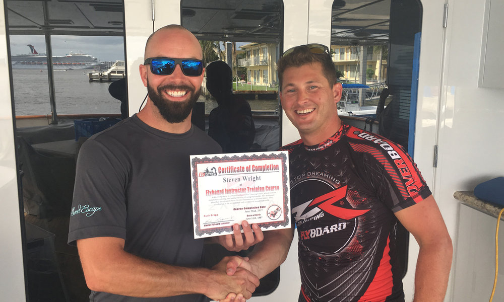 Steven Wright (left) of Motoryacht Sweet Escape receives his Certificate from Rush Bragg (right) upon completing the Flyboard Instructor Training Course.