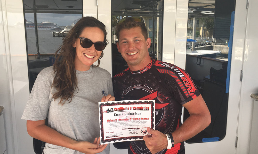 Emma Richardson (left) of Motoryacht Sweet Escape receives his Certificate from Rush Bragg (right) upon completing the Flyboard Instructor Training Course.