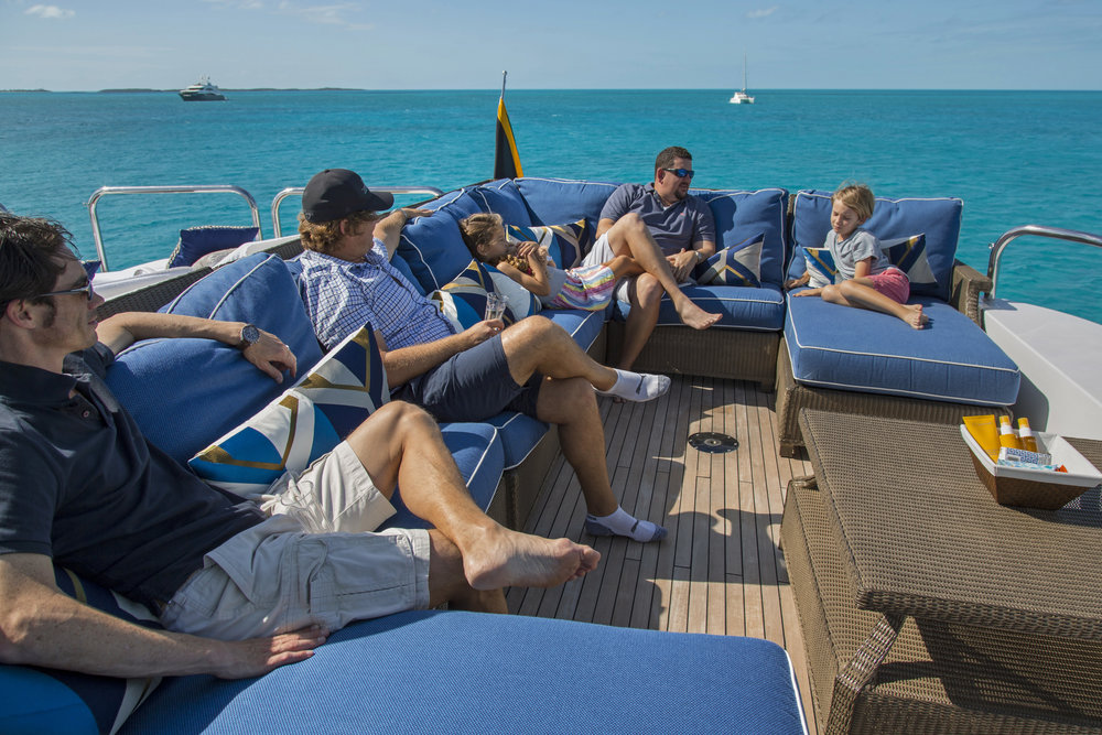 lounging-barefoot-charter-sunny-teak-BVI-Bahamas-luxury