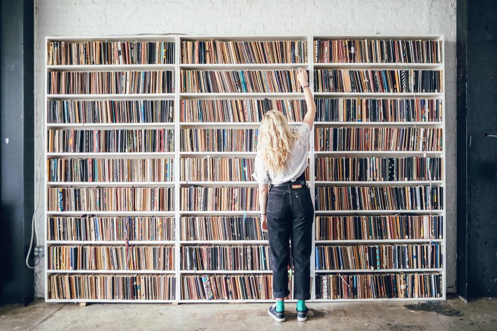 Sketchbooks on the shelves of Brooklyn Art Library