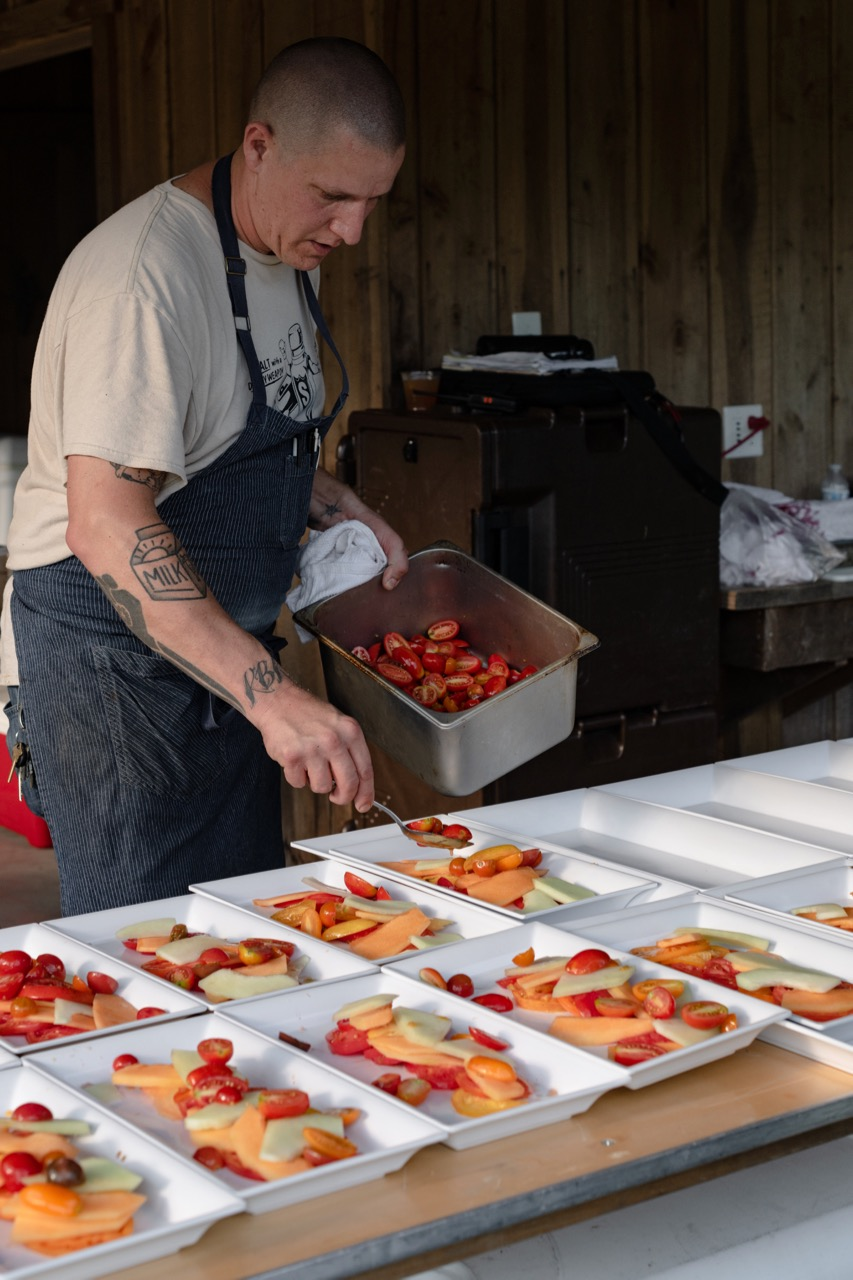 Travis_chef_plating_tomatoes.jpg