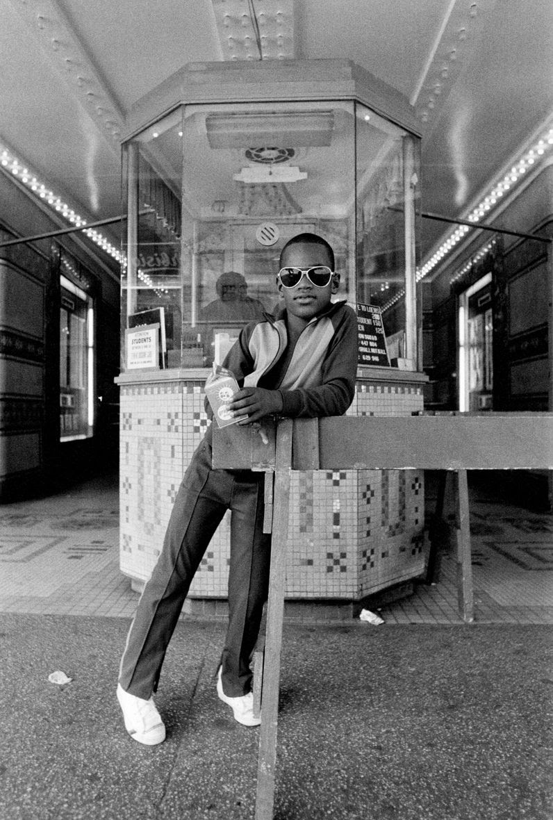 A Boy in front of the Loew's 125th Street Movie Theater , 1976 © Dawoud Bey / courtesy Stephen Daiter Gallery, Chicago, Stephen Bulger Gallery, Toronto