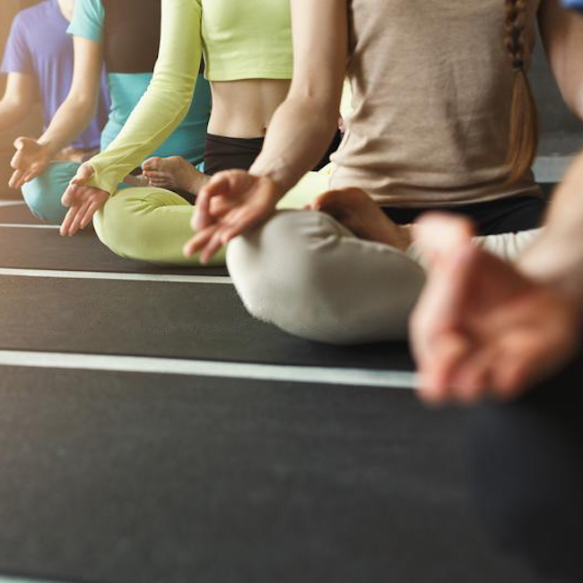 young-women-men-yoga-class-relax-meditation-pose-exercises-lotus-relaxation-healthy-lifestyle-fitness-club-crop-copy-114721325 (1).png