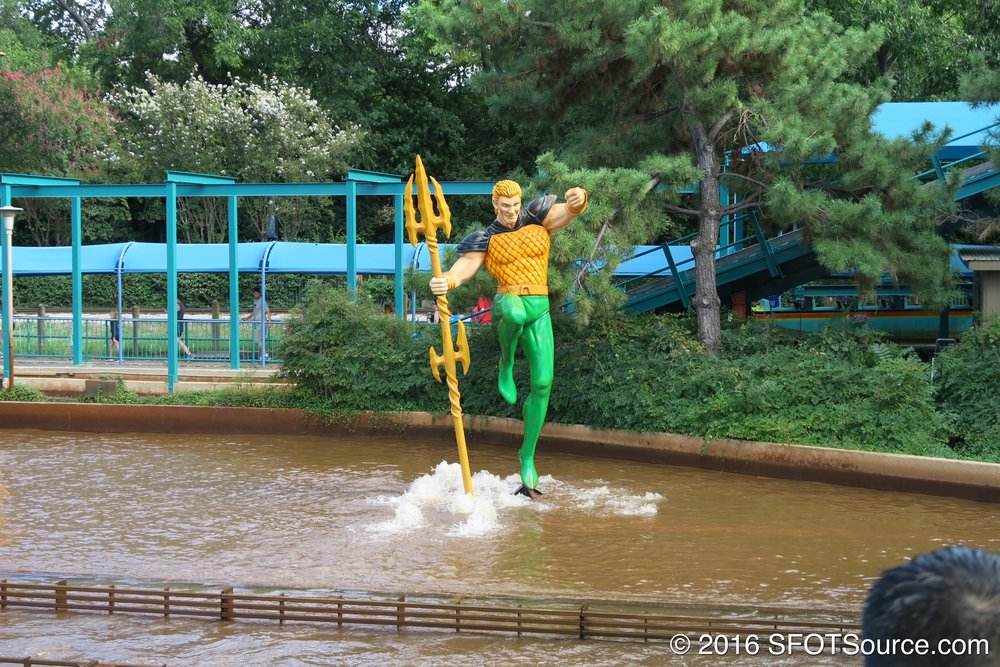 An Aquaman statue stands at the ride.