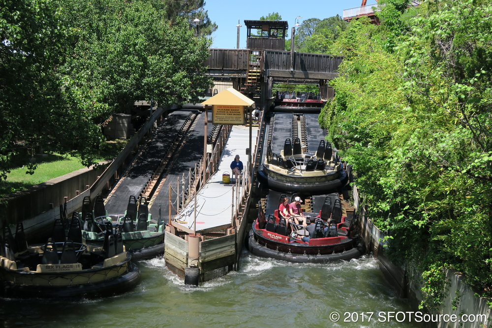 Boats return to the station at Roaring Rapids.