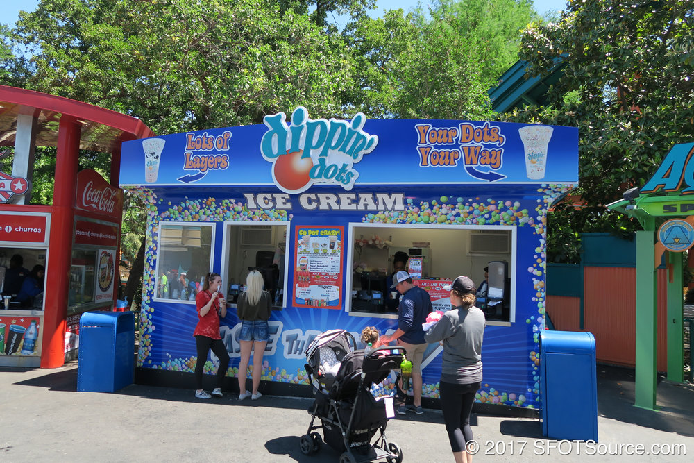 Aquaman Dippin' Dots is an outdoor food stand.