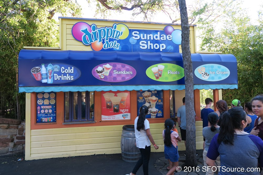 Dippin' Dots Sundaes is an outdoor food stand.