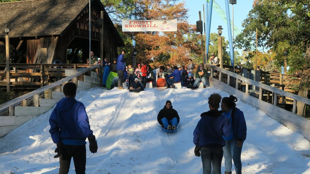 Frosty Snow Hill - Frosty Snow Hill is a Holiday in the Park classic. Guests can experience what it is like to sled down a legitimate snow hill. Located in the Tower section near the entrance of Music Mill Amphitheater.