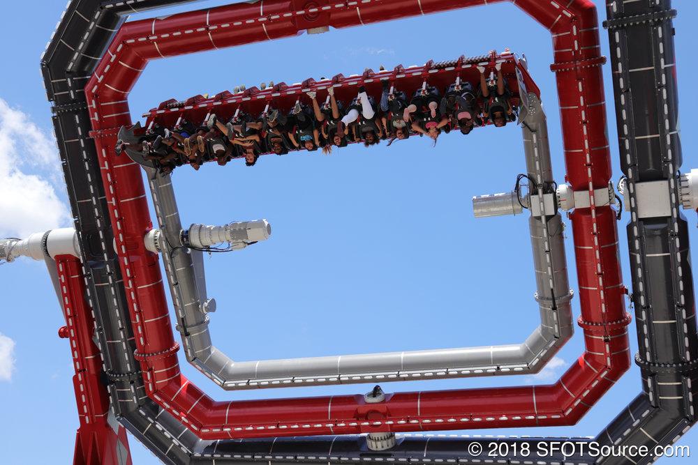 Riders being spun upside down.