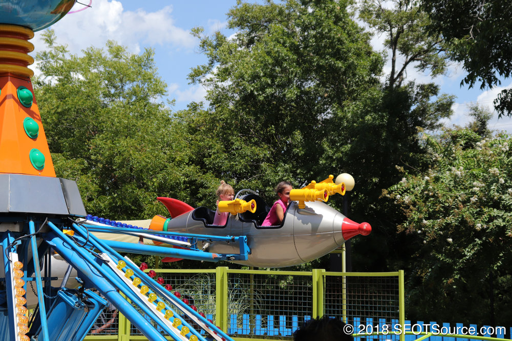 The ride cars are themed to space rockets.