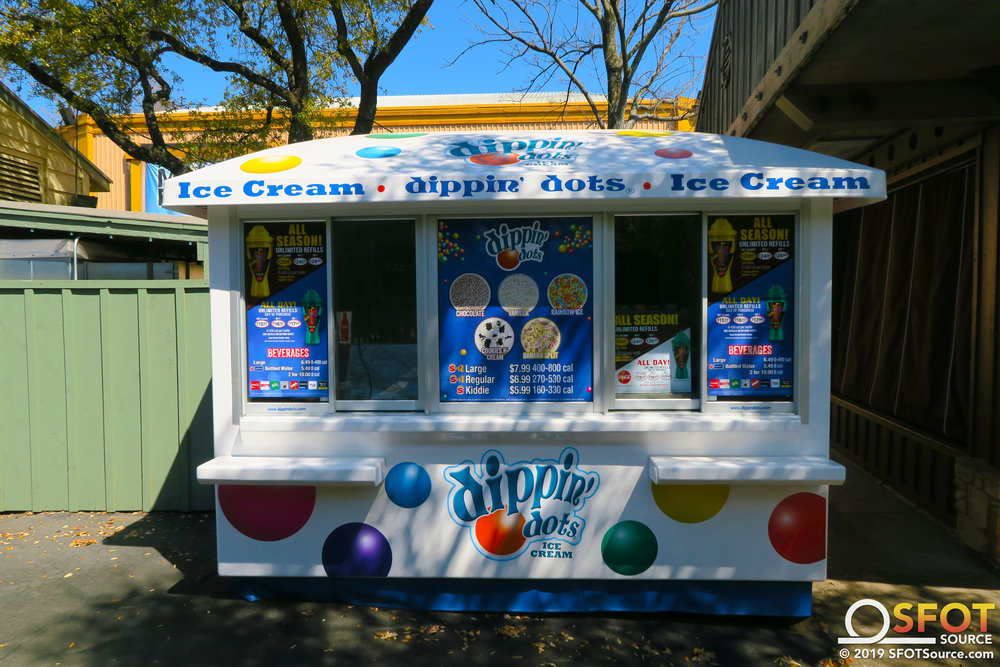 Tower Dippin' Dots is an outdoor ice cream stand located near Roaring Rapids.