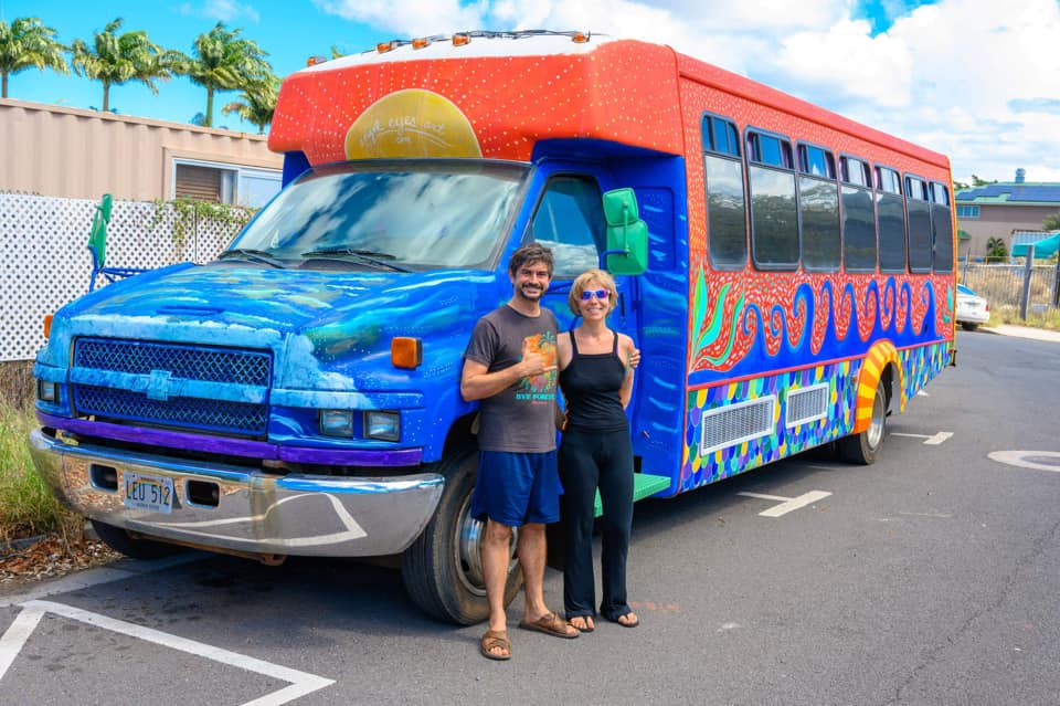 Me and my husband Paul, and the Wonder Bus (our tiny house on wheels that I painted) Our creative paradise!