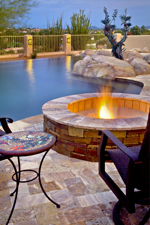 stone veneer fire pit and travertine pavers.jpg