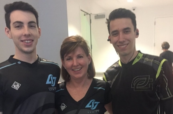 Stixxay, his mother, and PowerOfEvil posing as brothers after an LCS match. / Twitter