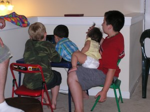 Once everything was over, the kids gathered around the laptop to watch music videos while the adults talked and kept themselves entertained.