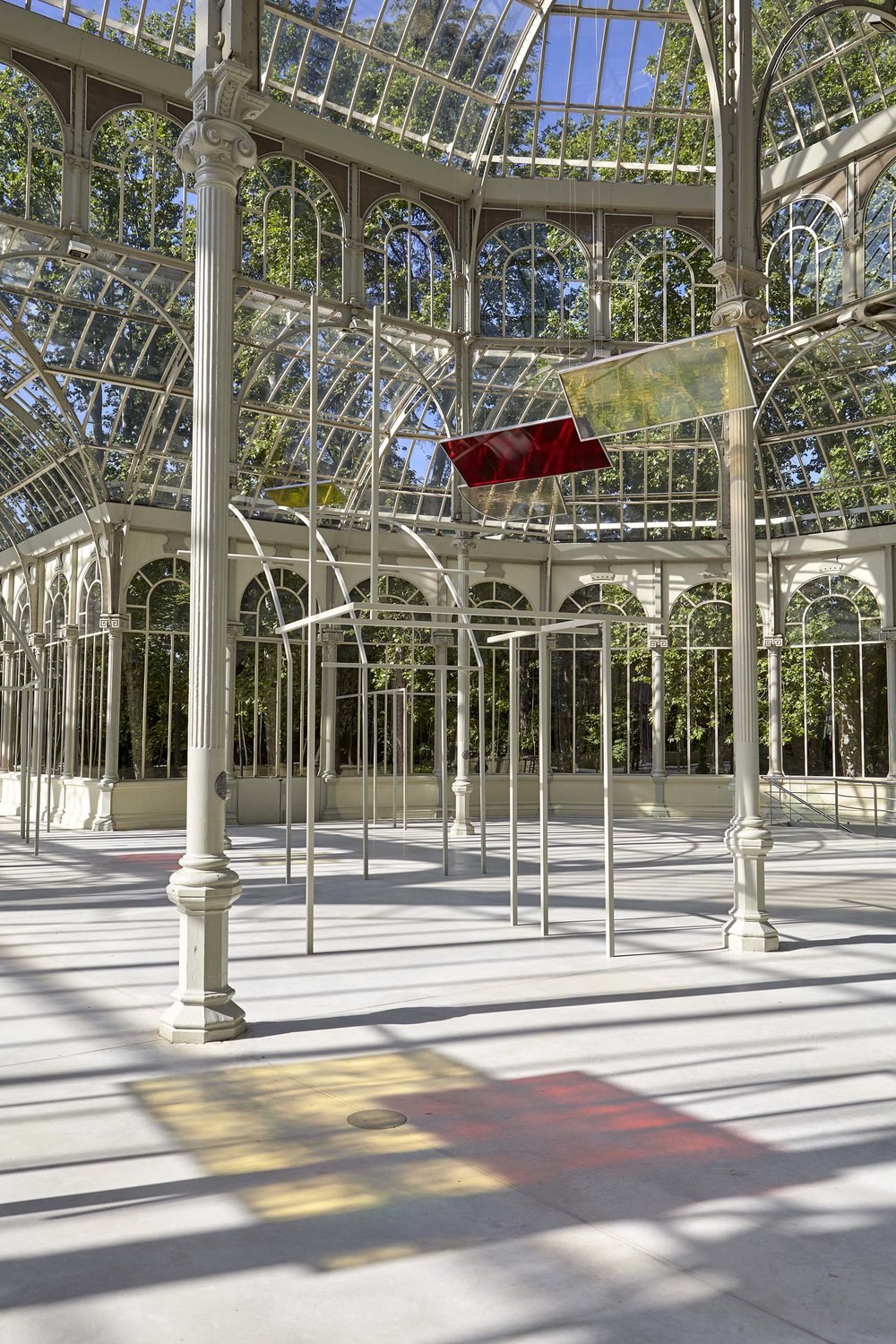 Rosa Barba,  Solar Flux Recordings , 2017; metal, color glass filters, and engraved plates. Installation view, Palacio de Cristal, Museo Nacional Centro de Arte Reina Sofía, Madrid. Photo: Joaquín Cortés / Román Lores © Rosa Barba