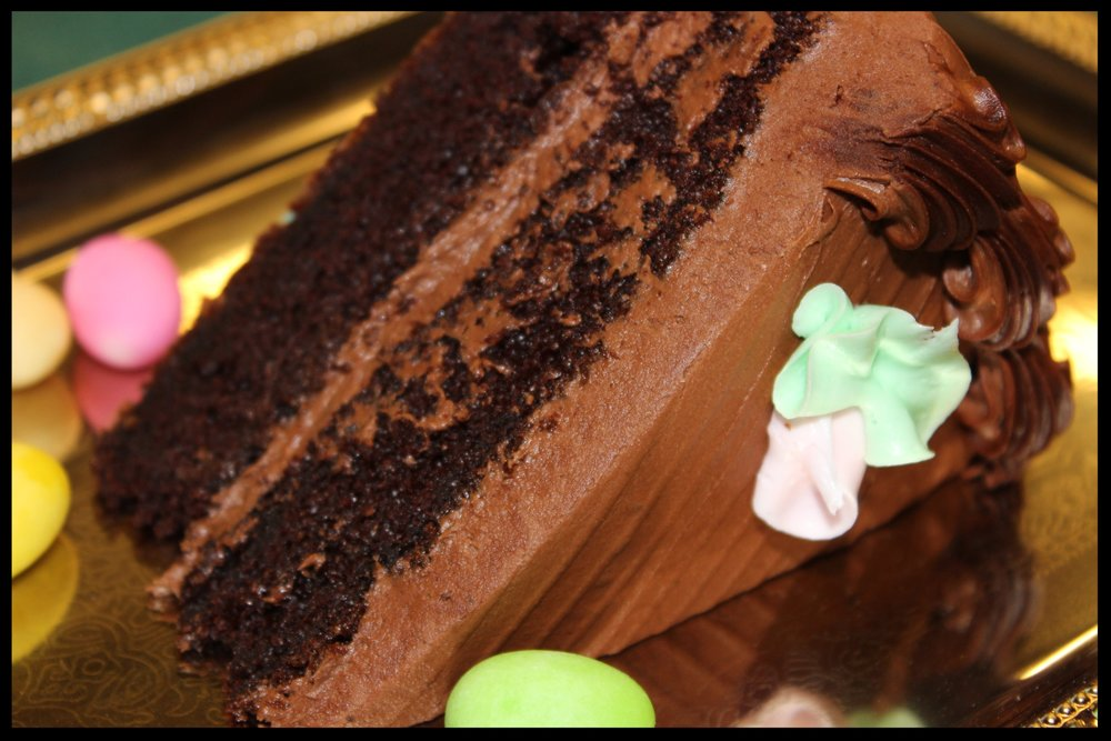 Chocolate Godiva Slice - A dense fudgy chocolate cake with chocolate buttercream filling and frosting.