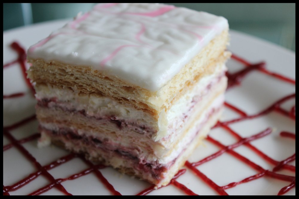 Raspberry Napolean - Layers of puff pastry dough, raspberry and lobster tail cream (whipped cream and vanilla cream mixed) under icing.