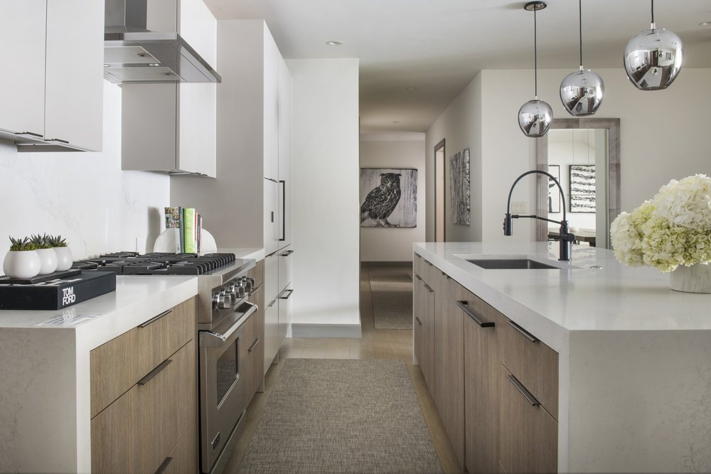 Kitchen with white furnishing and spacious cabinet