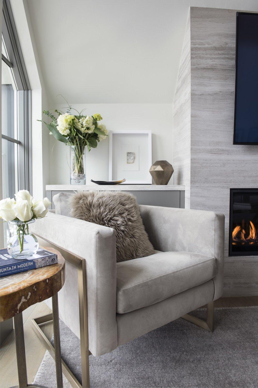 Elegant sofa with flower vase beside window